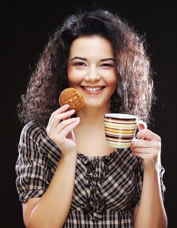 woman with coffee and cookies photo