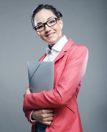 young business woman with folders photo