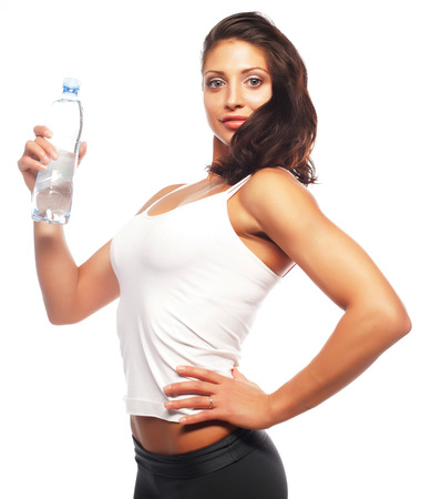 Smiling young sporty woman with water photo
