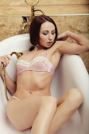 sexy lingerie woman posing in  bath photo
