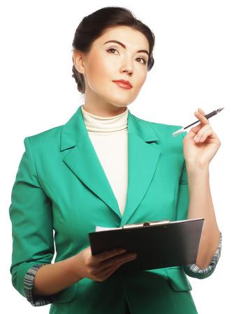 20 25: Portrait of writing businesswoman Stock Photo