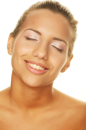 womanliness: young woman with happy smile Stock Photo