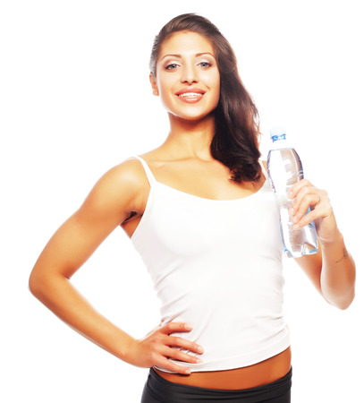 exercitation: Smiling young sporty woman with water