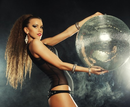 dancer girl in smoke with disco ball photo