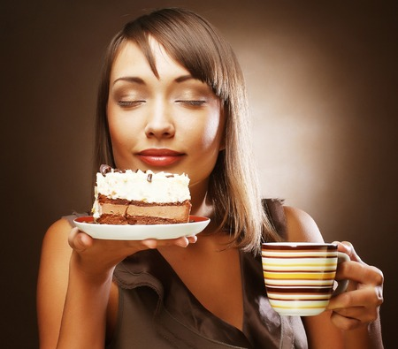 woman with coffee and dessert photo