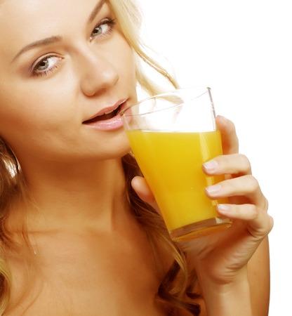 Woman holding orange juice photo