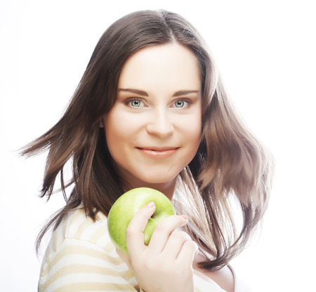 Portrait of young woman with green apple photo