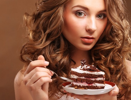 beautiful young woman with a cake photo