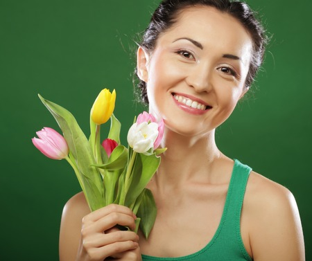 asian tulips: Happy asian girl with  tulips Stock Photo