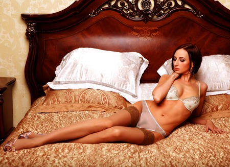 young elegant woman in bed Stock Photo