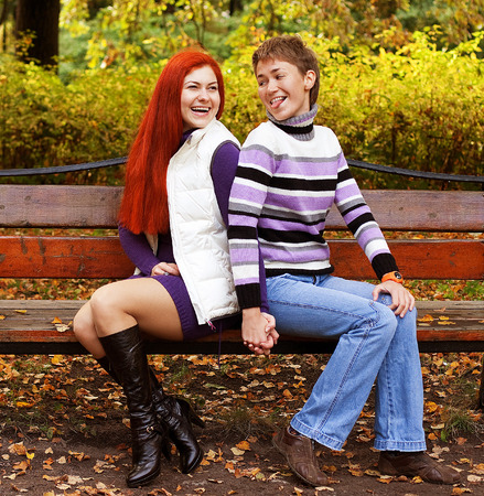 Two pretty girls  in autumn park photo