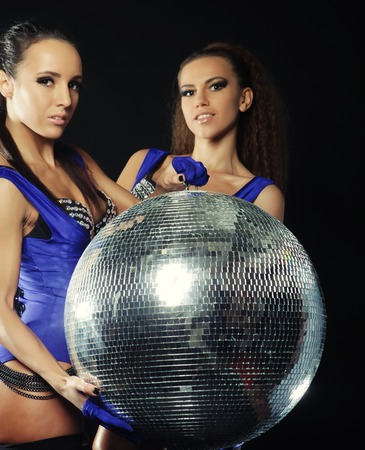 young dancer girls in smoke with disco ball photo