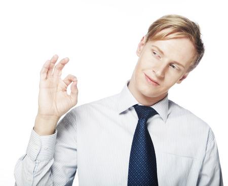 Man gesturing success sign. photo