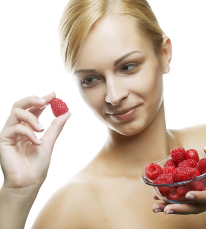 woman eating a raspberry. Isolated over white