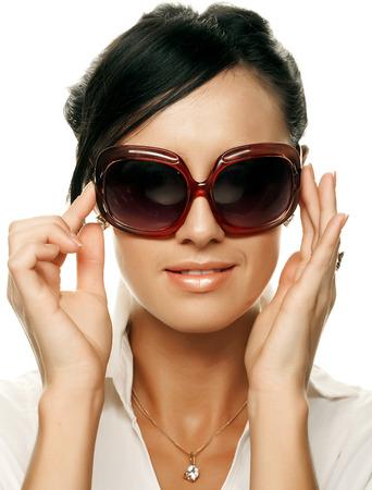 beautiful fashion woman wearing sunglasses Фото со стока