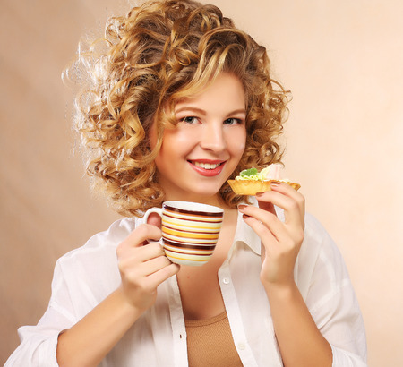 woman with coffee and cookies. photo