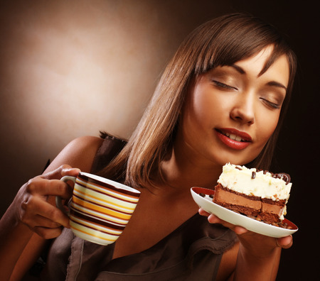 young woman with a cake and coffee