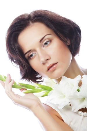 woman with gladiolus flowers in her hands photo