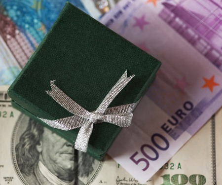 devaluation: present box and money - dollar and euro Stock Photo