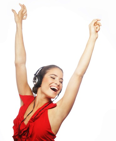 woman dancing to music with headphones
