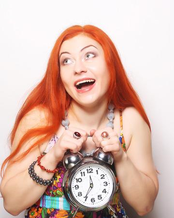 alarmclock: Young woman with alarmclock Stock Photo