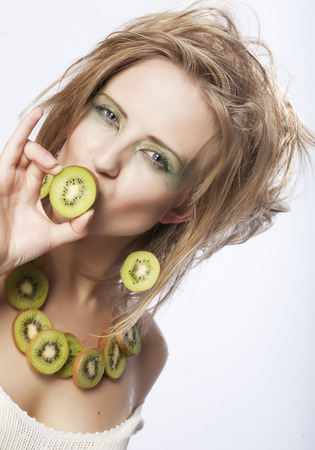helthcare: woman with kiwi on white