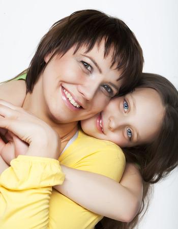 Daughter Hugging Mother photo