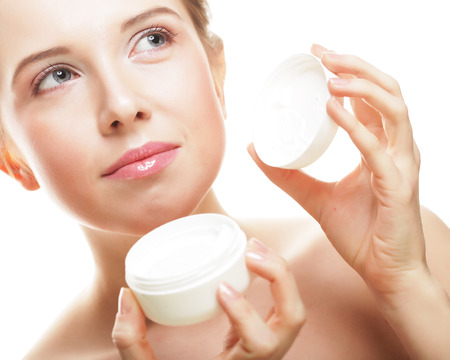 Beautiful spa girl holding jar of cream photo
