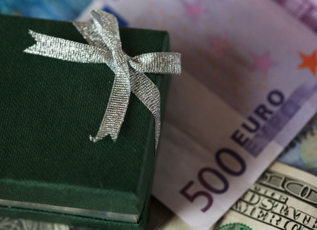 upvaluation: present box and money - dollar and euro Stock Photo
