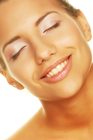 faultless: young woman with happy smile Stock Photo