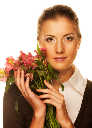 Young woman with pink flowers. photo
