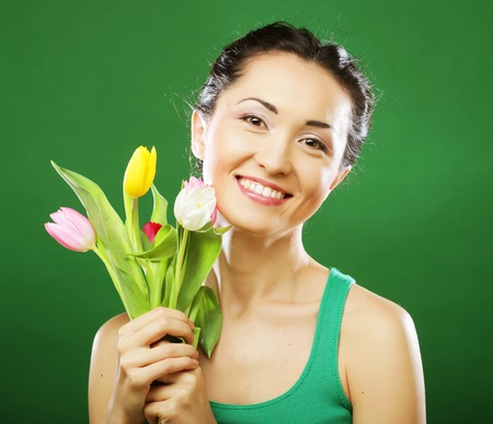 asian tulips: young asian woman holding a bouquet of tulips