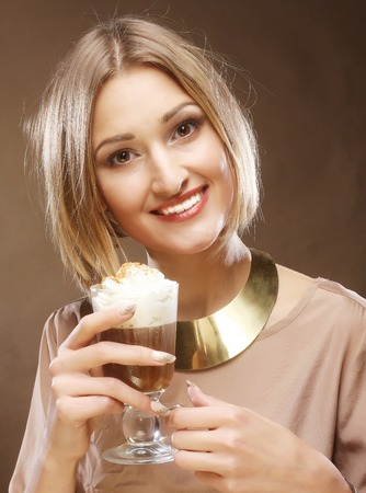 frothy: young woman holding cafe latte cup