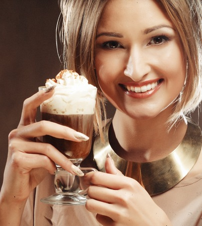 cafe latte: young woman holding cafe latte cup