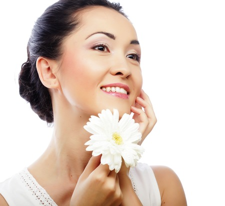 gerber flowers isolated on: young asian woman holding white gerber flower Stock Photo