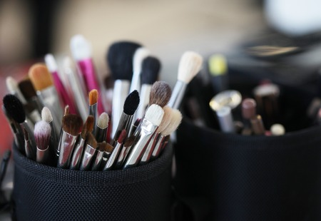make up products: Closeup of makeup tools in their holder