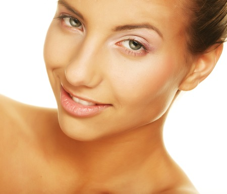 womanliness: Beautiful young smiling woman with healthy skin
