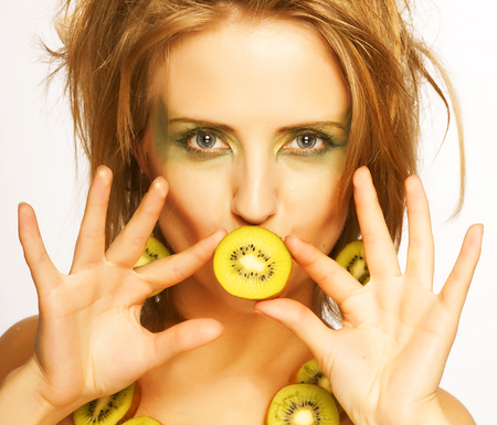 helthcare: beauty woman with kiwi on white
