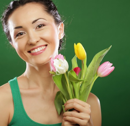 asian tulips: Happy asian girl with  tulips over  green background Stock Photo