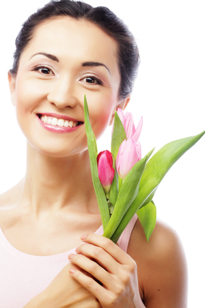 asian tulips: young happy asian woman with tulips over white background