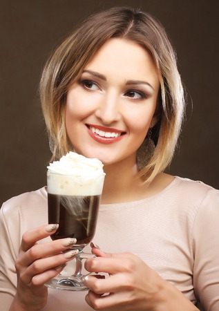 cafe latte: Portrait of young blond woman holding cafe latte cup Stock Photo