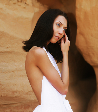 sensuality: Fashionable young attractive and sensuality woman in the desert