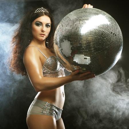 go go dancer: dancer girl in smoke with disco ball, night club