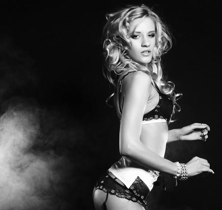 striptease: Fashion shoot of young sexy striptease dancer