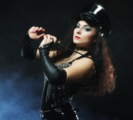 policewomen: sexy beautiful police woman over dark background with smoke Stock Photo