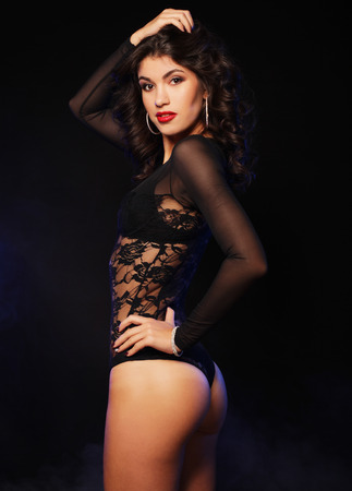 striptease: young sexy striptease dancer over dark background Stock Photo