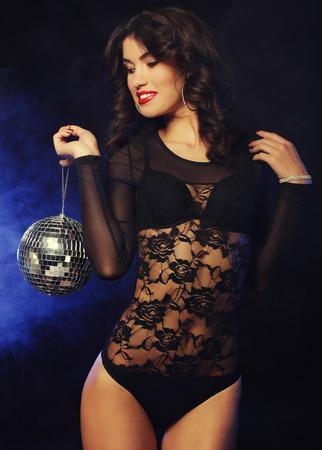 go go dancer: dancer brunette girl in smoke with disco ball