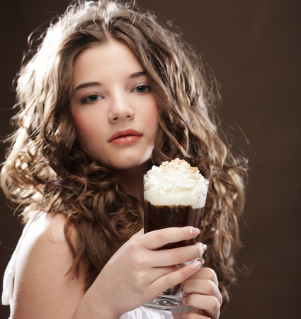 beauty girl with glass of coffee witn cream Stock Photo