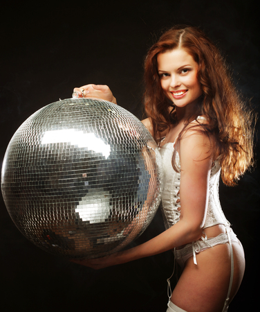 nude babe: dancer redhair girl  with disco ball over dark background