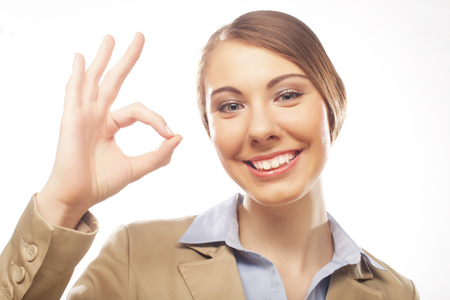 Happy businesswoman making an ok sign isolated on white Stock Photo